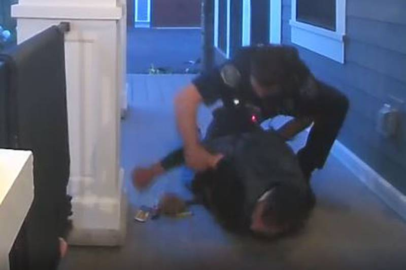 A Wyoming police officer stops a break-in suspect on the porch of a family's house.
