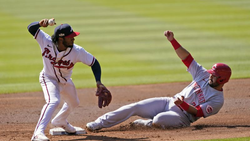 Atlanta Braves second baseman Ozzie Albies (1) throws to first after forcing out Cincinnati...