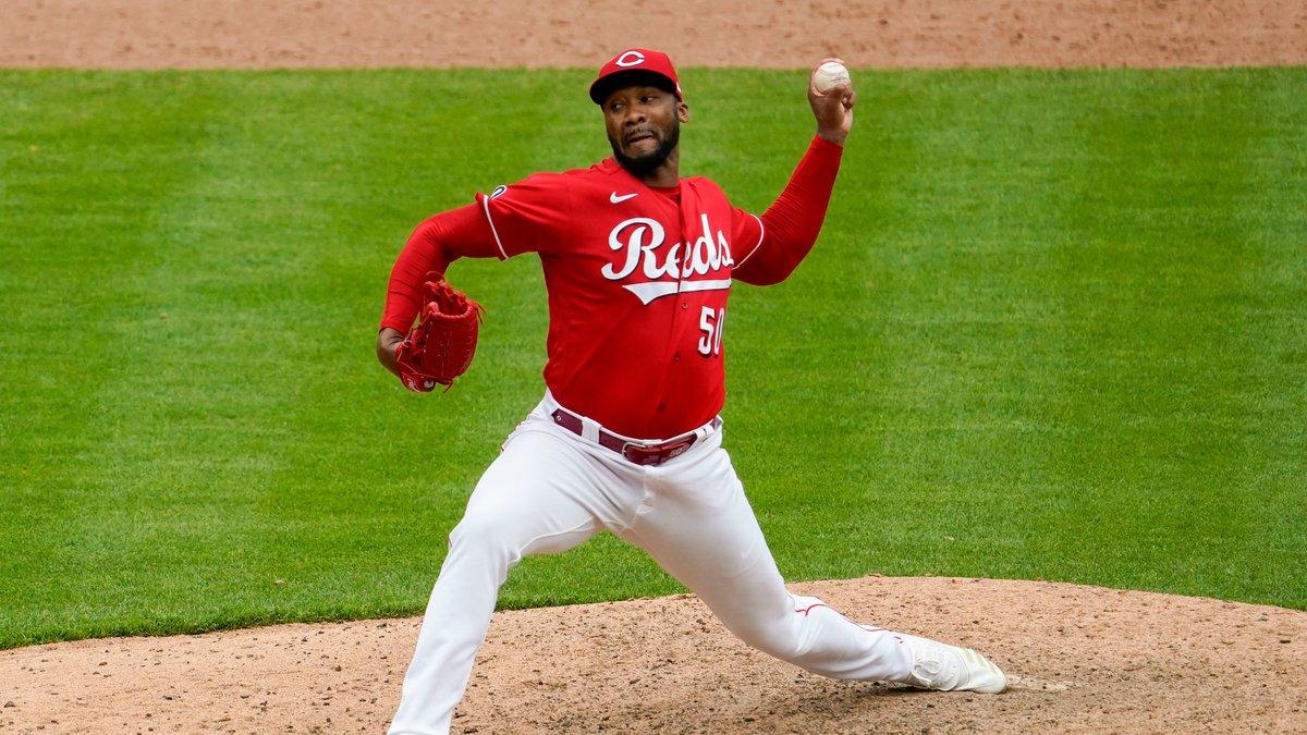 Cincinnati Reds relief pitcher Amir Garrett throws in the 10th inning during a baseball game...