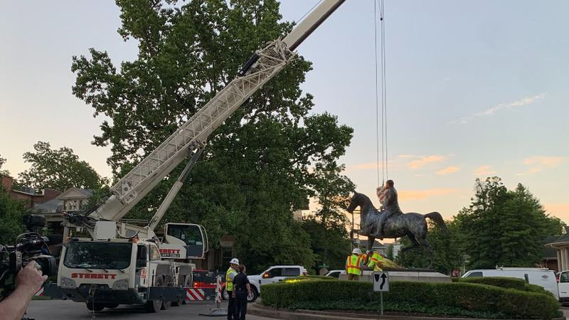 The John B. Castleman statue was lifted by a crane Monday morning.