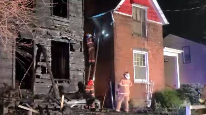 A fire destroys a home in Elmwood Place.