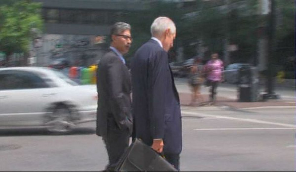 Durrani and his attorney exiting the courthouse after an arraignment on Monday.