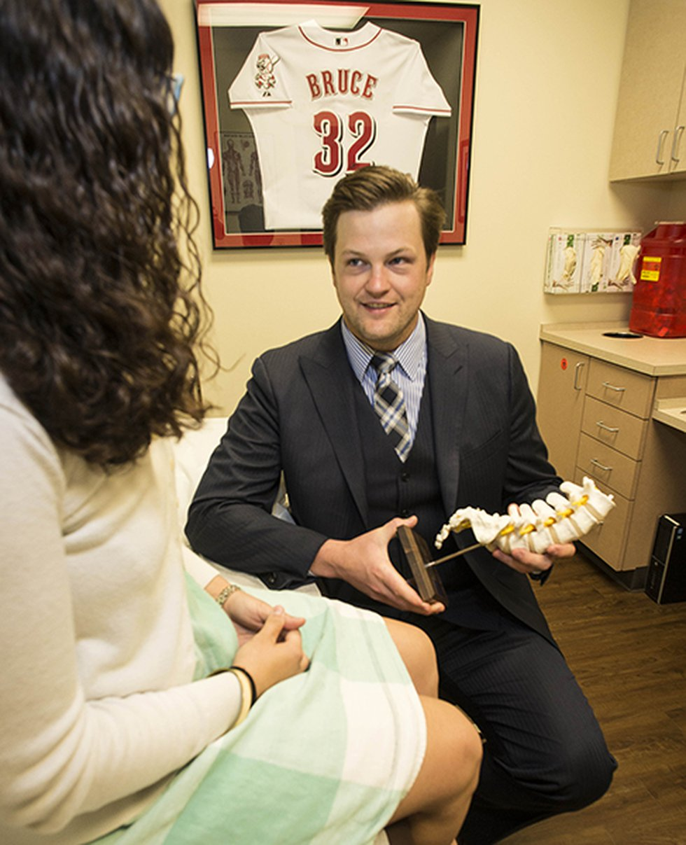 Beacon Orthopaedic Dr. Michael Planalp treats a patient at his clinic.