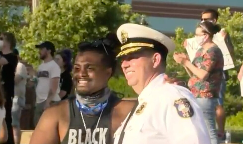 West Chester Police Chief Joel Herzog shaking hands with a protester at a rally on June 2.