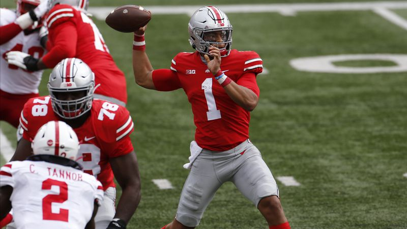 Ohio State quarterback Justin Fields throws a pass against Nebraska during the first half of an...