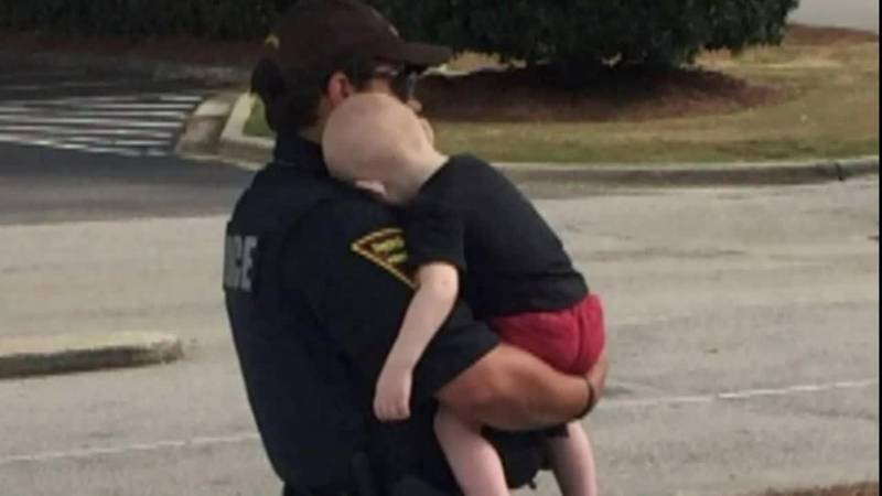 Police in North Carolina photographed an officer comforting a toddler whose parents had...