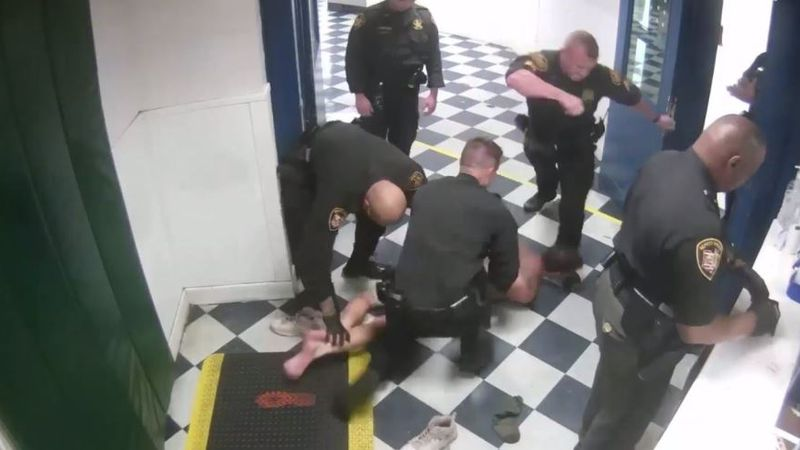 Video shows the deputy kick the inmate.