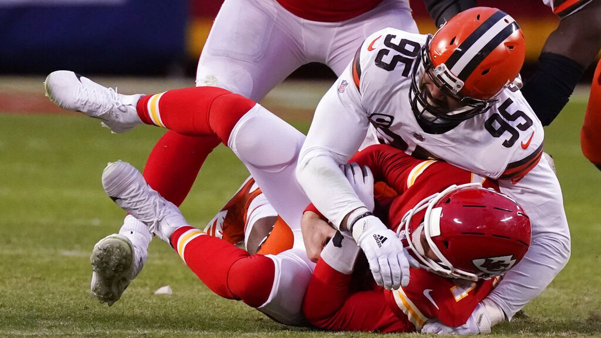 Kansas City Chiefs quarterback Chad Henne is sacked by Cleveland Browns defensive end Myles...