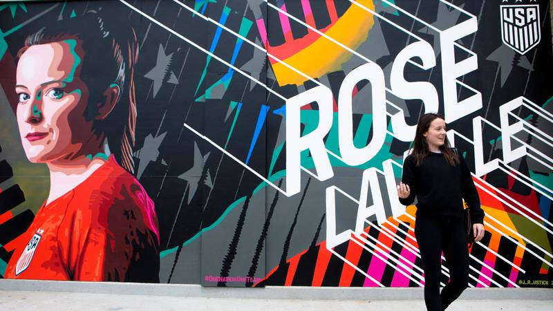 Jenny Ustick's mural of Rose Lavelle is next to the Taste of Belgium on Freedom Way.