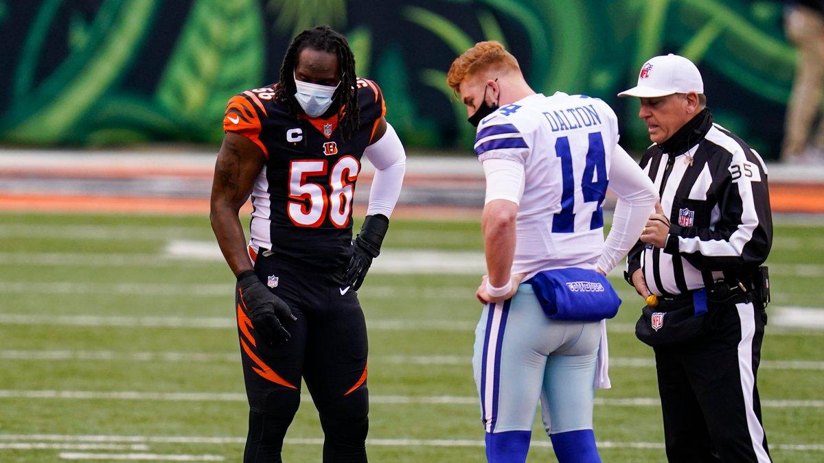 Dallas Cowboys quarterback Andy Dalton (14) and Cincinnati Bengals middle linebacker Josh Bynes...
