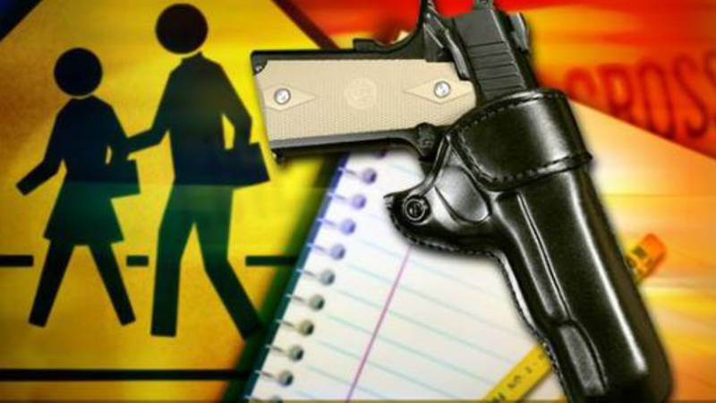 A southwestern Ohio school district's controversial policy allowing teachers and other staff...