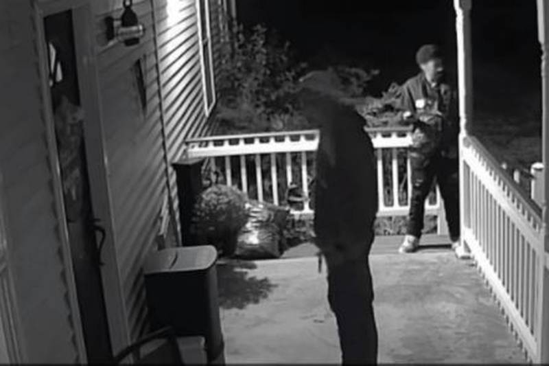 Security camera footage of an incident at a Morrow home where a woman says men approached her...