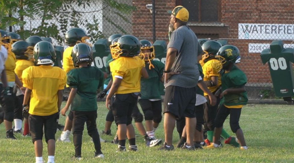 Rob Harris coaches the Lil' Senators Pee Wee Football team in the West End.
