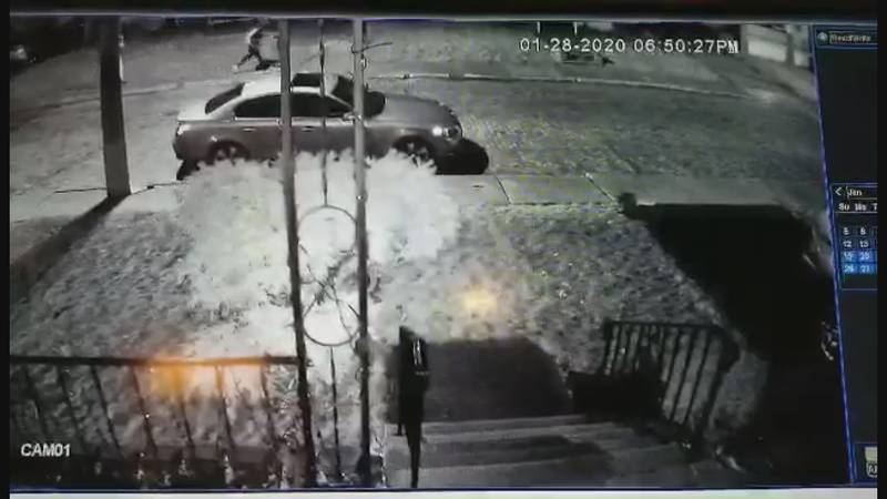 Neighbors surveillance video shows the crooks walking and the dad's truck following close behind.