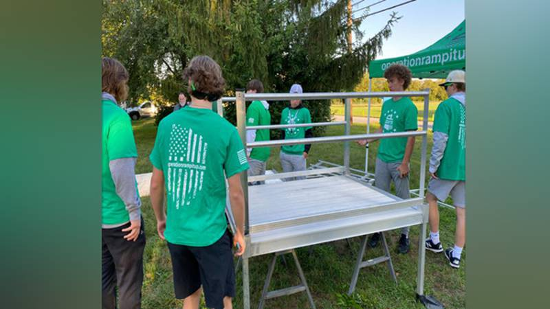 Badin High School seniors with Operation Ramp It Up help build a wheelchair ramp for a...