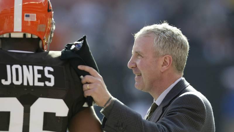 Cleveland Browns owner Randy Lerner talks with defensive back Sean Jones (26) before the...