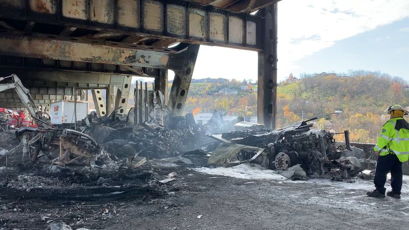 A truck carrying potassium hydroxide crashed into a jackknifed truck on the Brent Spence Bridge...