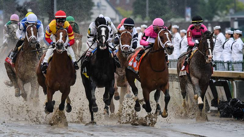 Take a look at some photos from a sloppy -- and controversial -- Kentucky Derby on Saturday at...